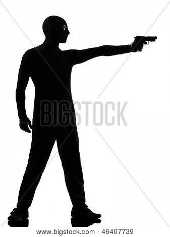 thief criminal terrorist man aiming gun in silhouette studio isolated on white background