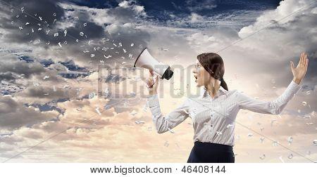 Businesswoman screaming in megaphone