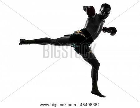 one caucasian man exercising thai boxing in silhouette studio  on white background