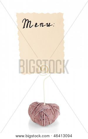 Beautiful holder in form of heart with menu isolated on white