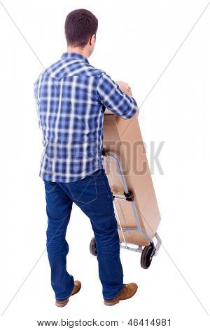 Young casual man moving a boxe with dolly, isolated on white background
