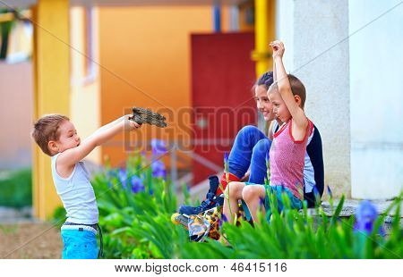 Small Kids With Toy Gun Playing In War, Colorful Outdoor