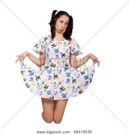 A Girl With Pigtails In Colorful Retro Dress