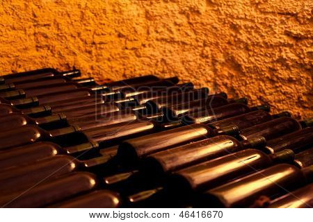 Wine Bottles In An Old Wine Cellar