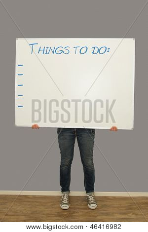 Woman Holding Things To Do Sign