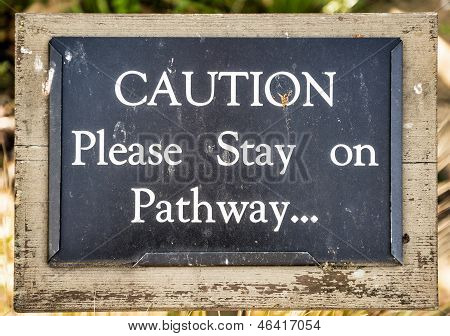 Coution Please Stay On Pathway..