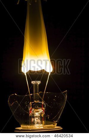 Broken Lightbulb With Filament Bursting Into Flame