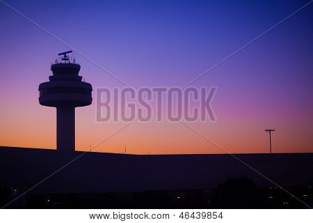Airport Control Tower At Sunset