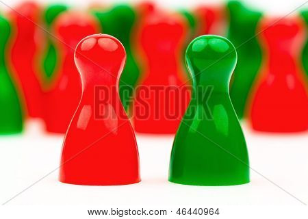 red and green pawns. coalition government between red and green.