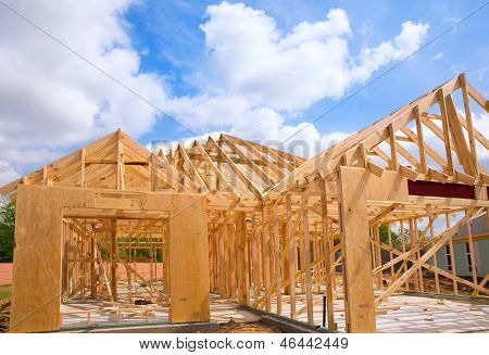 American residential wooden house construction detail in blue sunny day sky