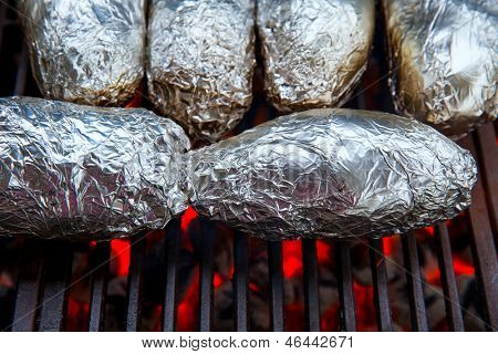 grilled whole potatoes with foil delicious meal and embers