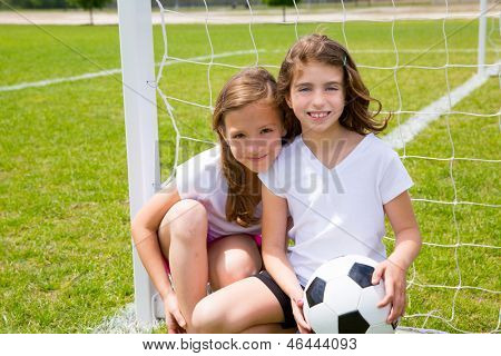 Soccer football kid girls playing on sports outdoor field