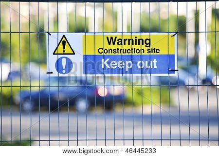 Warning Construction Area Sign On Site Fence