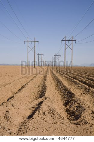 Plowed Field With High-tension Lines