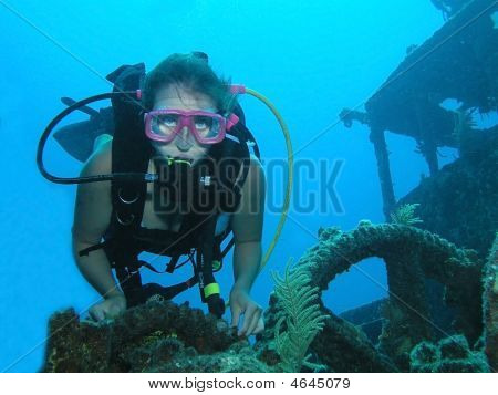 Young Female Scuba Diver On A Wreck Dive Site