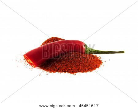 Sliced Red Chili Pepper With Hill Of Sweet Paprika