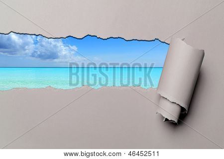 Torn paper with Caribbean beach in opening background