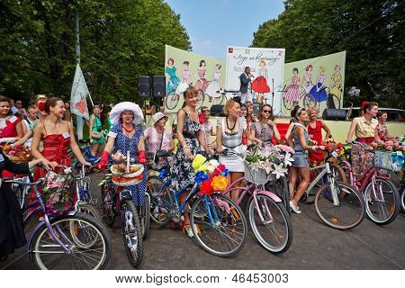 MOSCOW - AUG 5: Female participants of cycle parade Lady on Bicycle at Sokolniki park, August 5, 2012, Moscow, Russia. Parade is only for women, mandatory requirement - to correspond image of 1960th.