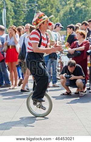 MOSCOW - AUG 5: Clown perform on single-wheel bicycle on day of cycle parade Lady on Bicycle at Sokolniki park, Aug 5 2012, Moscow Russia. Main goal of event is to attract attention to cycling in city