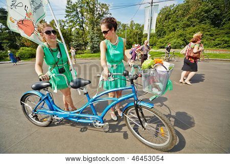 MOSCOW - AUG 5: Participants of cycle parade Lady on Bicycle at Sokolniki park, August 5, 2012, Moscow, Russia. This parade is only for women, mandatory requirement - to correspond image of 1960th.