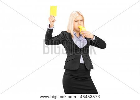 Angry businesswoman blowing a whistle and showing a yellow card, isolated on white background