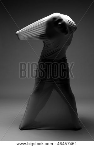 Horror Image of a Woman Trapped in Fabric