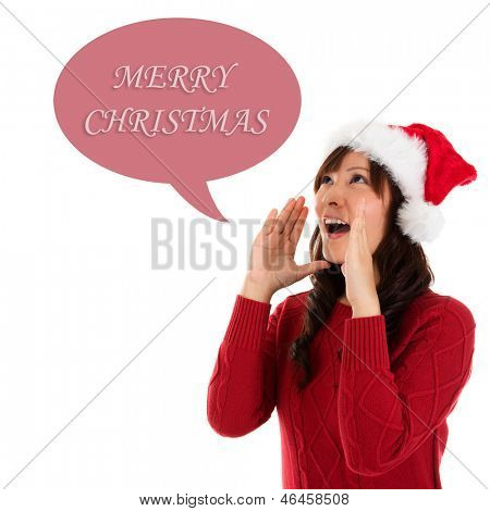 Happy Christmas woman shouting excited isolated on white background wearing red Santa hat. Beautiful Asian model.