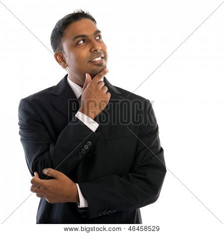 Indian man thinking. Confident young Indian businessman thinking, looking up and standing isolated on white background.