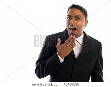 Indian businessman surprise. Good looking Indian man in black suit showing surprising face, isolated on white background.