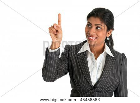 Indian businesswoman finger touching virtual transparent screen key. Smiling happy isolated on white background. Asian female model.