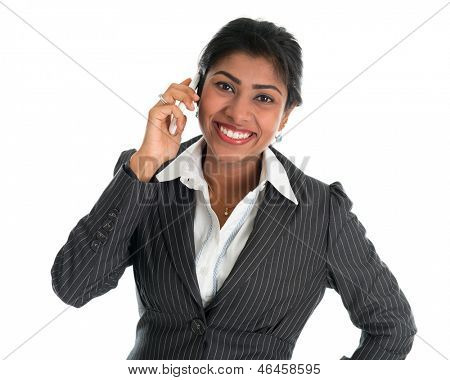 Indian woman talking on phone. Smart Indian business woman on the phone smiling happy isolated on white background. Beautiful Asian female model.