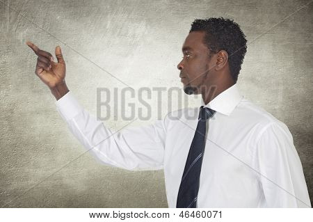 African businessman pointing something on a gray background