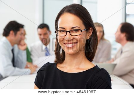 Portrait Of Businesswoman Sitting At Boardroom Table