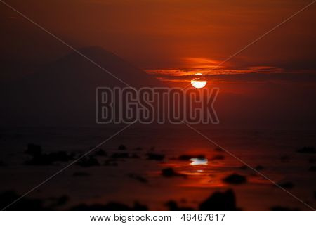 Sunset On The Ocean - View Of Volcano Batur. Indonesia, Bali.