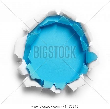 Hole Ripped In White And Blue Paper