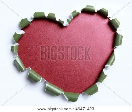 White Torn Paper In Green Paper With Heart Shape