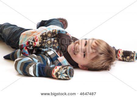 Smiling Boy On White Floor