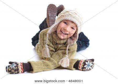 Happy Boy In Winter Clothing