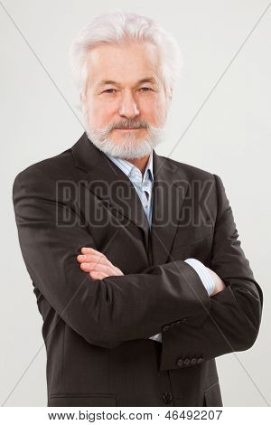 Handsome elderly man with beard isolated over white background