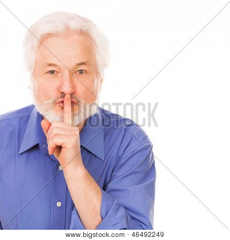 Handsome elderly man asks to silence with finger on lips isolated over white background