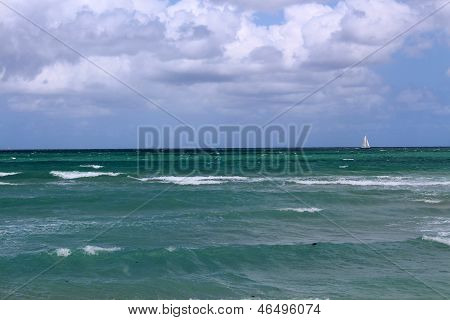 Lone sailboat on the horizon