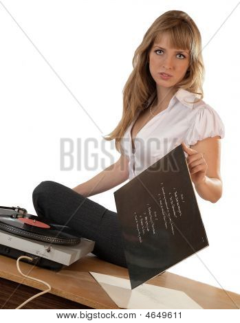 The Girl Listens To  Vinylic Disk On A White Background