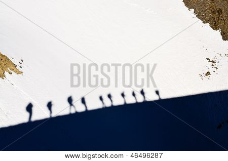 Shadows Of Group Of Mountain Trekkers On A Snow