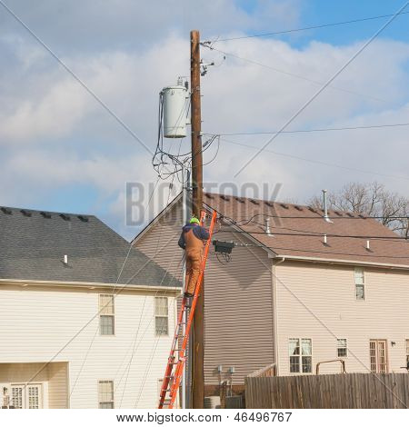Electrician Worker At  Electric  Power Pole.