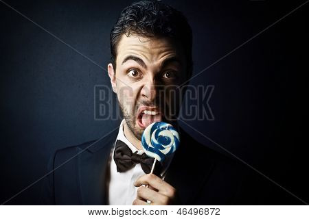 disgusted elegant man with lollipop