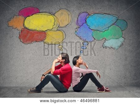 couple sitting on the floor thinking