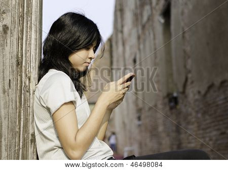 Young Woman Typing A Message On Mobile Phone