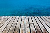 stock photo of dock a lake  - Concept Image of a Wooden Dock Besides the Sea - JPG