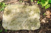 picture of generous  - Stepping stone with quote to happiness and dappled shadows - JPG