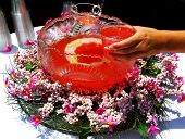 pic of punchbowl  - Hand holding glass of punch over punchbowl - JPG